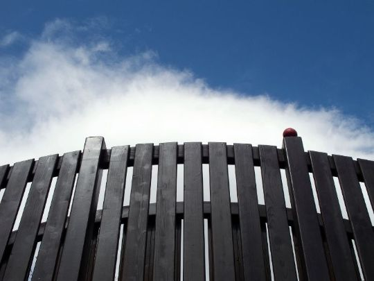 deep-colored timber fencing installation } Rockhampton Fencing Pros